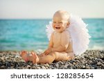 Cute Baby With Angel Wings Is...