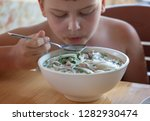 child eats traditional... | Shutterstock . vector #1282930474
