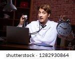 young handsome doctor working...   Shutterstock . vector #1282930864