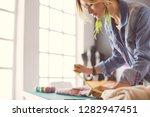fashion designer woman working... | Shutterstock . vector #1282947451