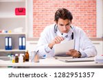 young doctor working in hospital   Shutterstock . vector #1282951357