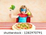 superhero child eating... | Shutterstock . vector #1282970791