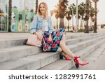 pretty smiling woman sitting on ... | Shutterstock . vector #1282991761