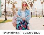 pretty smiling woman walking in ... | Shutterstock . vector #1282991827
