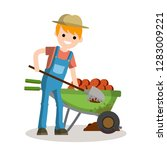 rural boy digging potatoes with ... | Shutterstock .eps vector #1283009221