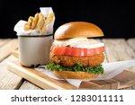 tasty fried chicken burger... | Shutterstock . vector #1283011111