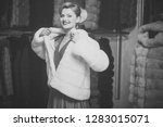 woman in fur coat  shopaholic.... | Shutterstock . vector #1283015071