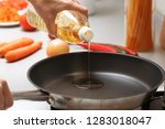 home cooking. a woman pouring... | Shutterstock . vector #1283018047