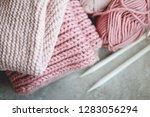 woolen pink yarn and a knitting ... | Shutterstock . vector #1283056294