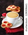Cup of coffee and cookies on a dark wooden background. - stock photo