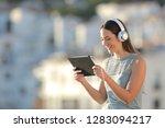 happy woman watching media... | Shutterstock . vector #1283094217
