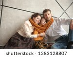 portrait of a happy family with ... | Shutterstock . vector #1283128807