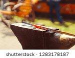 a blacksmith hammering a hot... | Shutterstock . vector #1283178187
