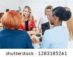 young mixed race women team up...   Shutterstock . vector #1283185261