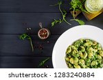conchiglie pasta with spinach... | Shutterstock . vector #1283240884
