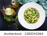 conchiglie pasta with spinach... | Shutterstock . vector #1283241064