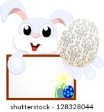 easter bunny with egg | Shutterstock .eps vector #128328044