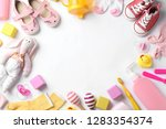 Stock photo flat lay composition with baby accessories and space for text on white background 1283354374