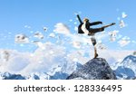 young businesswoman standing on ... | Shutterstock . vector #128336495