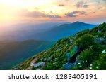 wide summer mountain panorama... | Shutterstock . vector #1283405191