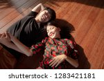 asian younger man and woman... | Shutterstock . vector #1283421181