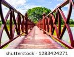 red wooden bridge in sukhothai... | Shutterstock . vector #1283424271