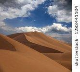 big sand dunes in sahara desert   Shutterstock . vector #1283441104