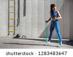 female athlete using a stretch... | Shutterstock . vector #1283483647