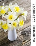 white daffodils at china vase... | Shutterstock . vector #1283485087