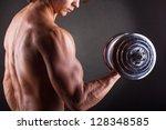 closeup of a muscular young man ... | Shutterstock . vector #128348585