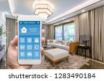 smart phone with smart house ... | Shutterstock . vector #1283490184