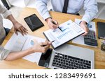 business team are working with... | Shutterstock . vector #1283499691