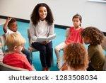 young female school teacher... | Shutterstock . vector #1283508034
