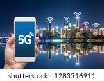 hand holding mobile smart phone ... | Shutterstock . vector #1283516911