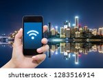 smart phone in hand and using... | Shutterstock . vector #1283516914