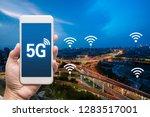 hand holding mobile smart phone ... | Shutterstock . vector #1283517001