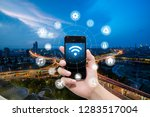 smart phone in hand and using... | Shutterstock . vector #1283517004