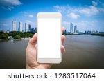 business man hand holding white ... | Shutterstock . vector #1283517064