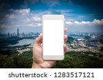 business man hand holding white ... | Shutterstock . vector #1283517121