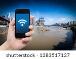 smart phone in hand and using... | Shutterstock . vector #1283517127