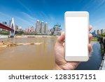 business man hand holding white ... | Shutterstock . vector #1283517151