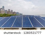 solar and modern city skyline  | Shutterstock . vector #1283521777