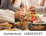 friends eating tasty chinese... | Shutterstock . vector #1283525197