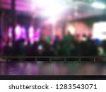 wooden table on blurred club... | Shutterstock . vector #1283543071