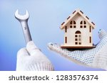 fixing house problems concept.... | Shutterstock . vector #1283576374