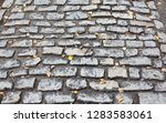 wet cobble stones after the...   Shutterstock . vector #1283583061
