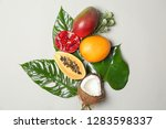 tropical fruits and leaves on... | Shutterstock . vector #1283598337