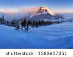 foggy morning panorama of... | Shutterstock . vector #1283617351