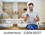 man brushing teeth and using... | Shutterstock . vector #1283618257