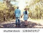 young couple holding hands and... | Shutterstock . vector #1283651917